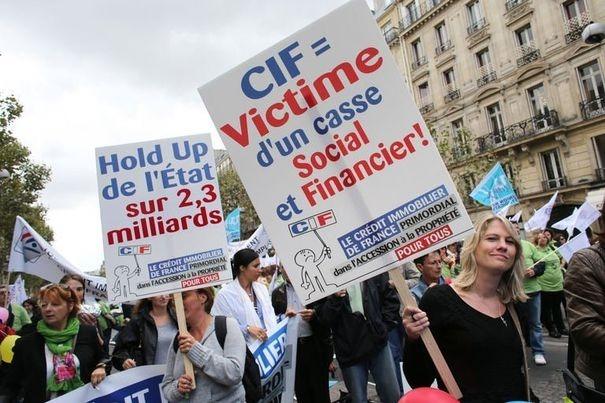 410860_des-employes-du-credit-immobilier-de-france-cif-manifestent-le-13-septembre-2012-a-paris
