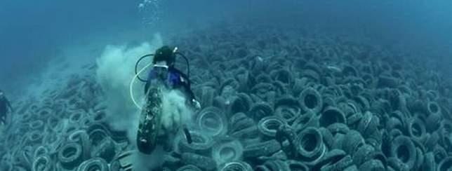 ocean-pollution-tire-on-ocean-floor
