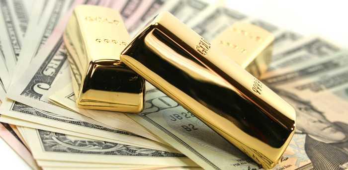 Gold bullion on dollar bills