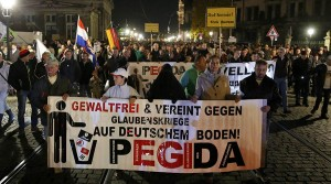Supporters of the anti-immigration rightwing movement PEGIDA (Patriotic Europeans Against the Islamisation of the West) march during their weekly gathering in the historic part of Dresden, Germany October 26, 2015. REUTERS/Fabrizio Bensch